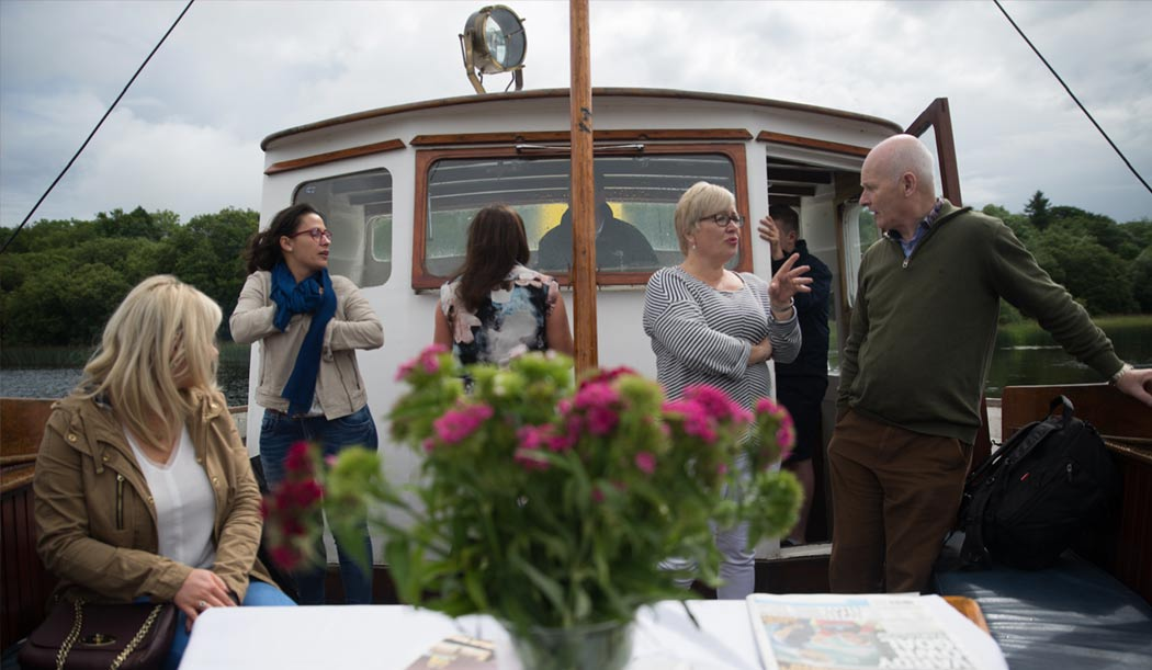 Guests boating on Belle Isle's Trasna
